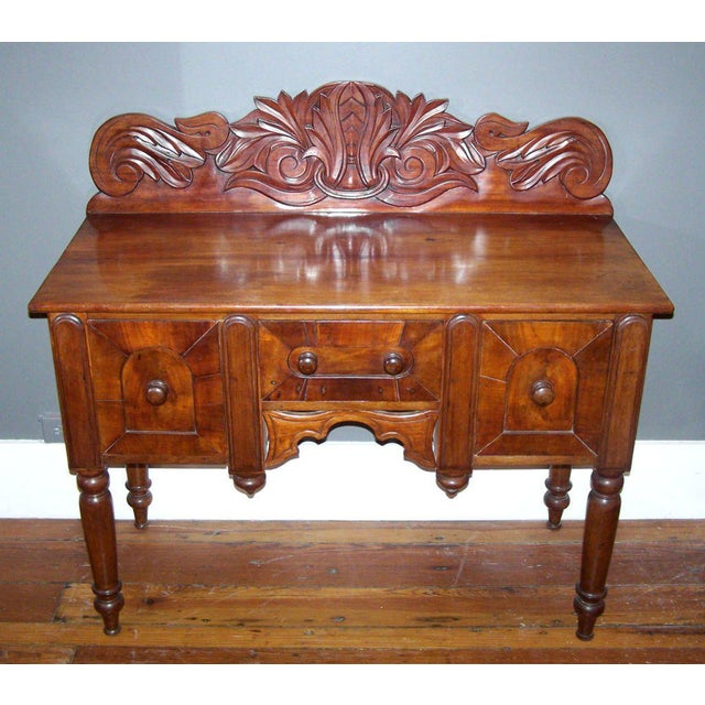 A rare cupping or serving board from Barbados, circa 1830. This West Indies sideboard has mahogany primary wood with...