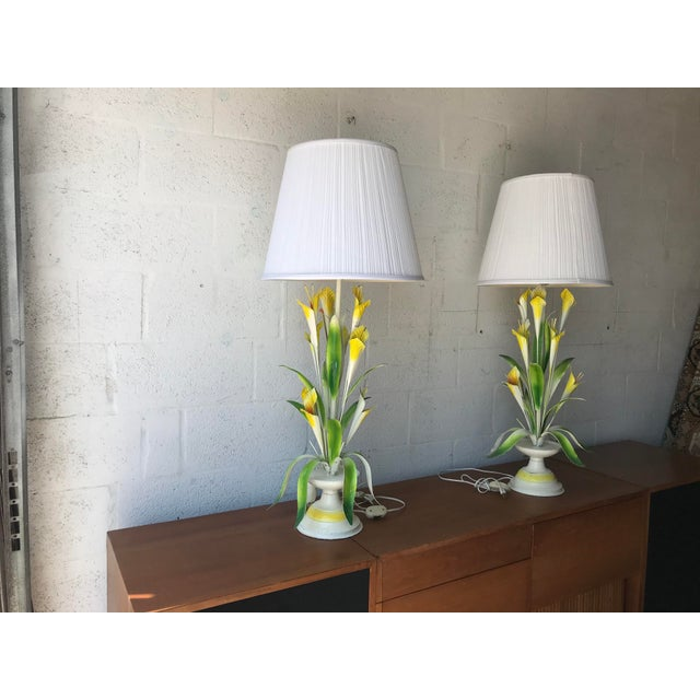 """Vintage pair of Italian Tole Lamps. Floral Bouquet of Lilies and green leaves. The lamps are tall 39 """" to the top. The..."""