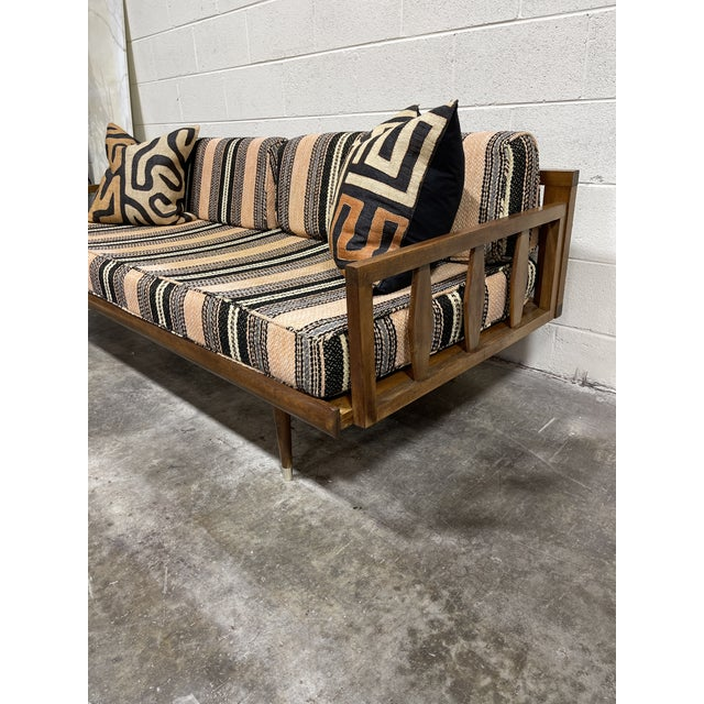 This is a great mid century walnut daybed signed made in Yugoslavia. The cushions are faded, but still have lots of life...