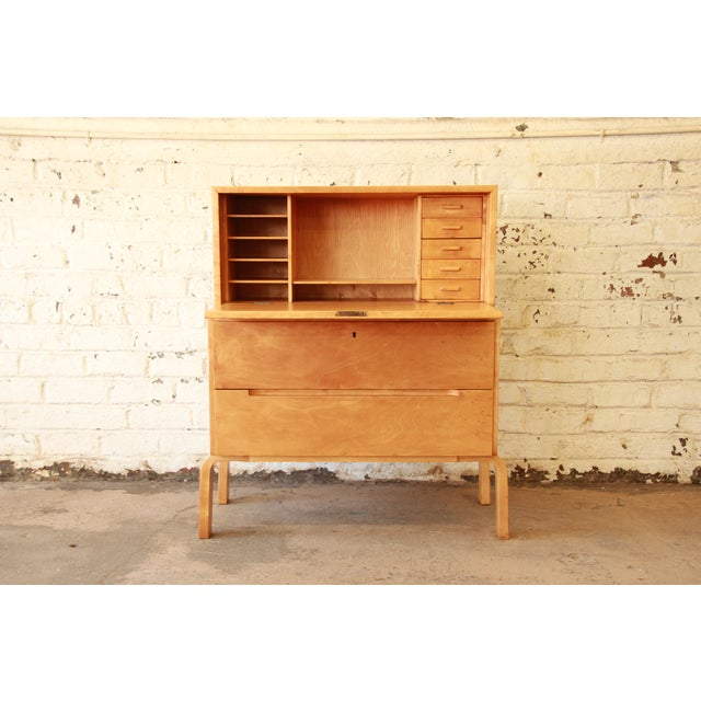 Extremely rare early edition model 802 secretary desk by renowned architect Alvar Aalto. This desk offers a unique early...