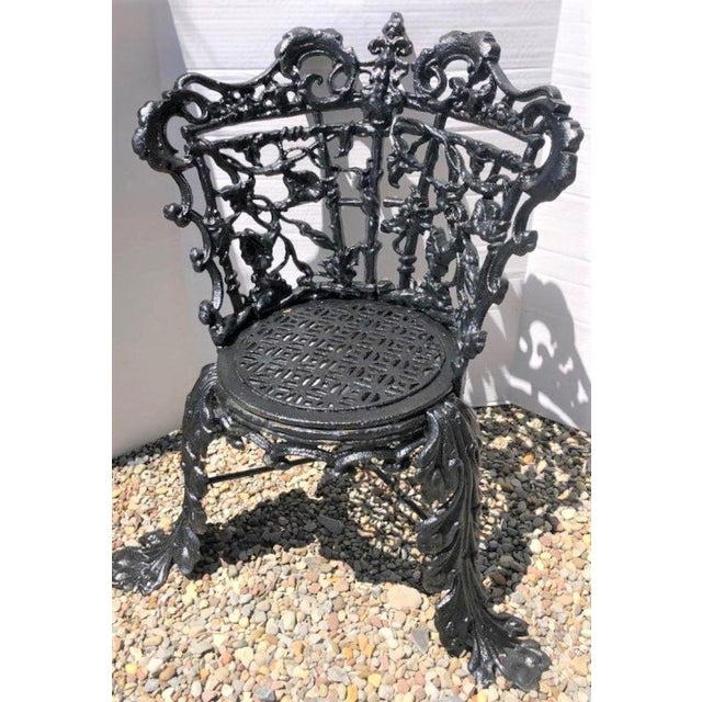 """This cast iron garden chair dates to the late 19th century and is in the """"Marigold"""" pattern and has been acquired from an..."""