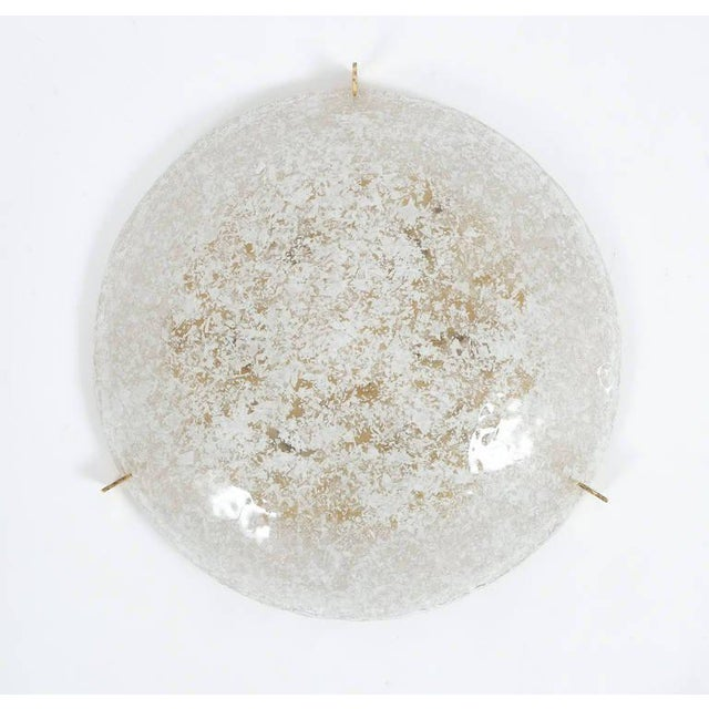 Large 21 inch textured white and clear glass ceiling light with brass hardware in very good condition. The fixture holds...