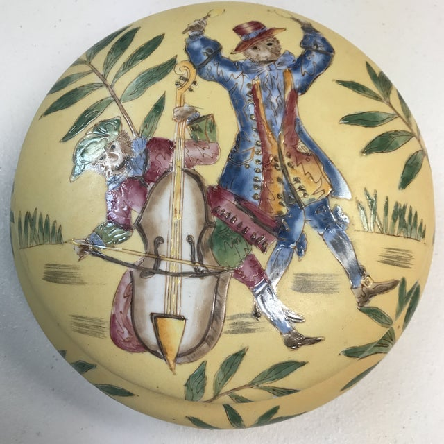 Beautiful, heavily detailed monkeys playing instrument and floral design on lid and base with heavy accents. An circle...