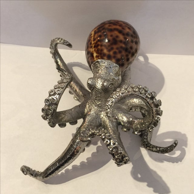 Wonderful squid or octopus made from genuine shell as the body of this art piece. Has metal legs. You can just see it...