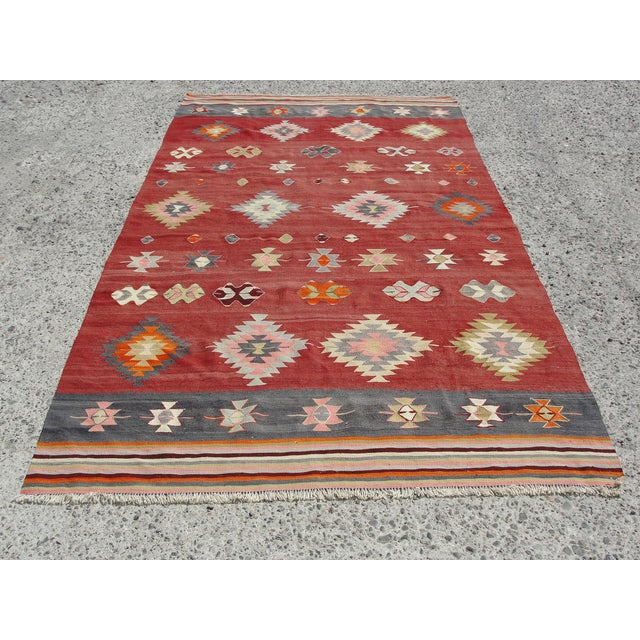 Vintage handwoven Turkish kilim rug. The kilim is nearly 45 years old. It is handmade, of very fine quality natural wool...