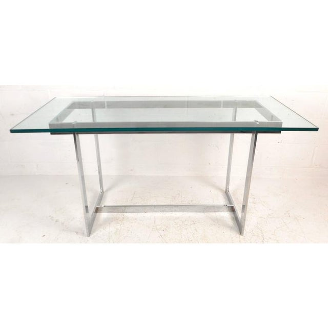 """Stunning vintage modern console table features a heavy sculpted chrome frame and a 1"""" thick green beveled glass top. This..."""