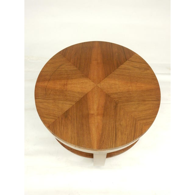 Walnut veneered 1930's walnut round side table. The table has a shelf, handy for magazines and coffee table books.