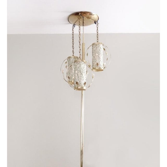 An exceptionally unique vintage tension pole lamp from the 1950's. The saucer at the top rests against your ceiling with...