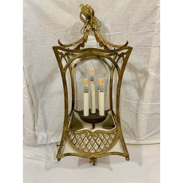 How is this for charming? gilded iron and painted tole come together to make a wonderful and unusual lantern or...