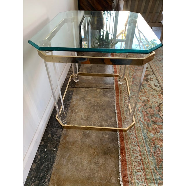 Attributed to Charles Hollis Jones, this unique side table is made with acrylic/lucite legs, gold chrome accents and thick...