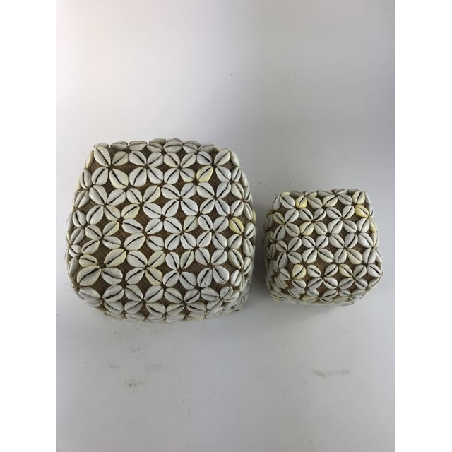 I love these baskets. They are woven rattan baskets with cowrie shells sewn onto the outside of them. There are 2 baskets...