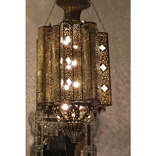 Oversized 6' high, spectacular, exquisite pierced brass Moorish Moroccan chandelier. This exquisite light fixture is...