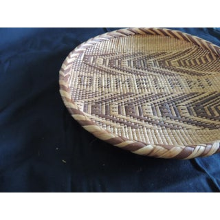 Round Natural and Brown Woven Tribal Basket With Braided Rim Preview