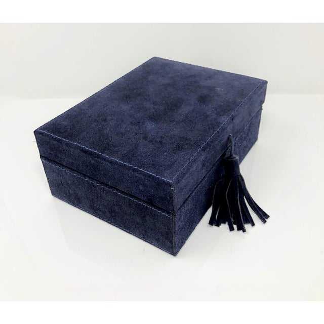 This authentic suede leather decorative box is in a beautiful shade of navy. This keepsake box also features a suede...