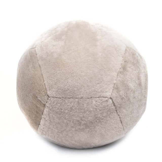 Featured in shearling, the Ottoman X is inspired by fundamental geometry. These structured and supportive round ball...