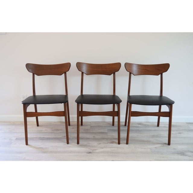 Beautiful Mid Century Modern Danish chairs. Four dining chairs. Refinished in Dark walnut and new faux leather upholstery....