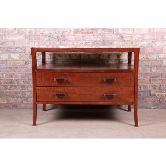 A gorgeous modern marble top buffet server or entry table By Bill Sofield for Baker Furniture USA, Early 21st Century...