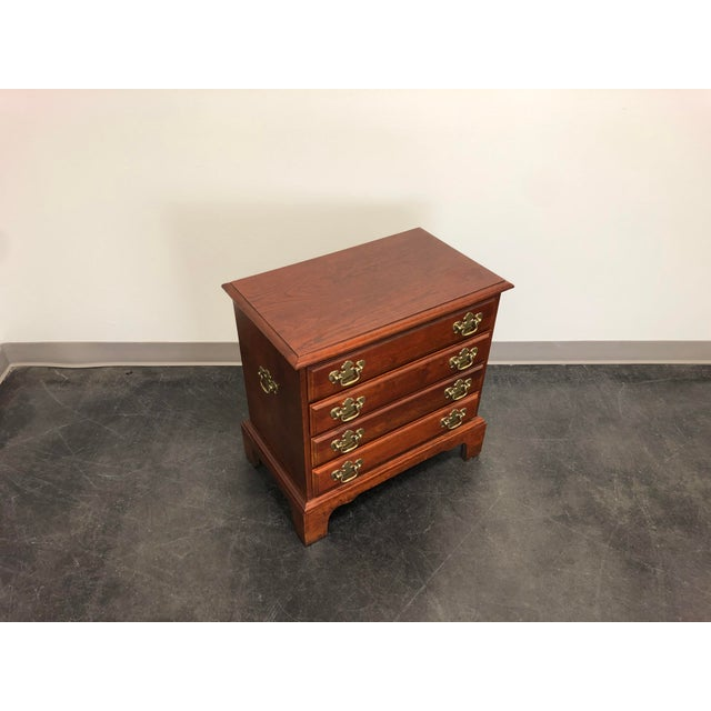 A Chippendale style chairside chest by Hooker Furniture. Made in the USA in the late 20th Century. Solid Cherry wood with...