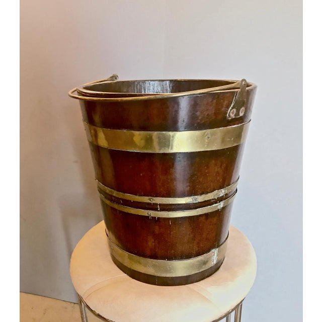 This a great English mahogany peat bucket that dates to the end of the 18th c./early 19th century. The bucket is in...