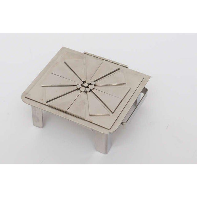 This signed stainless steel one of a kind hinged box by Stanley Szwarc Box has a beautiful flower motiff in modern form...