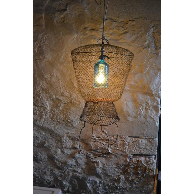 Pendant Light from Seltzer Bottle Suspended in French, Steel Mesh Fish Basket - Image 6 of 11