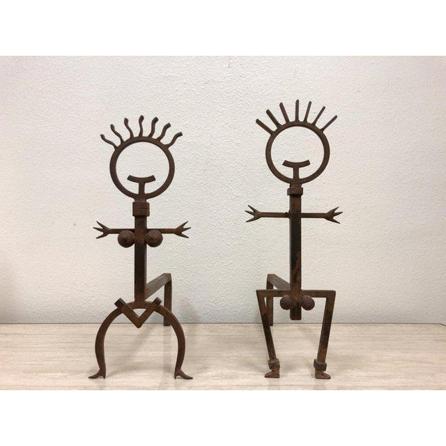 A cool pair of Brutalist male and female fireplace andirons from the 1970s. This are in original condition, so they show...