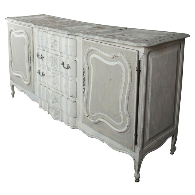 19th century french provincial scalloped sideboard. Features a whitewashed finish and light gray doors showing a wonderful...