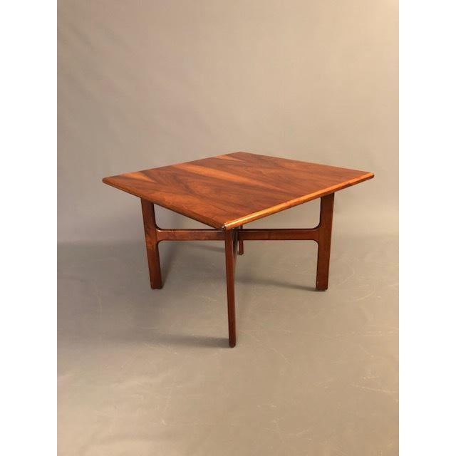 Mid-Century walnut Coffee table by D.Mcguire with beautiful round corner and cross base legs some ware on the top and...