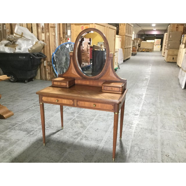 Beautiful French Art Deco vanity. Made of walnut, this vanity features two drawers in the front with two smaller drawers...