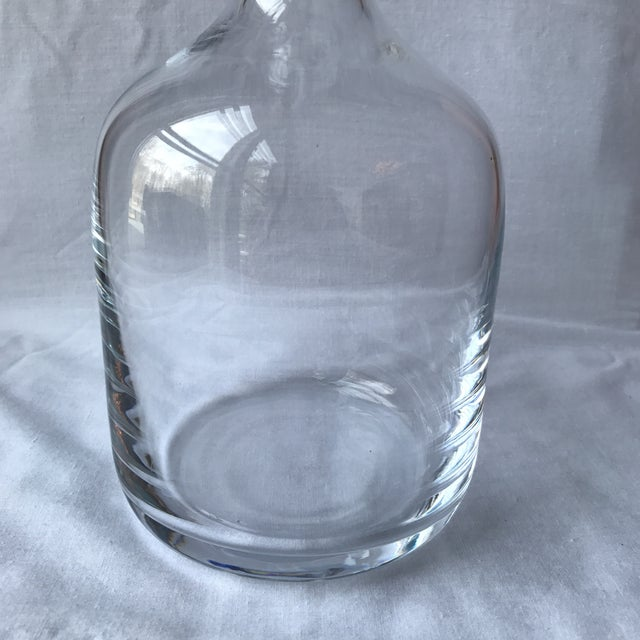 Vintage glass decanter with a simple, modern design and chunky stopper. In mint condition and ready for a fabulous bar.