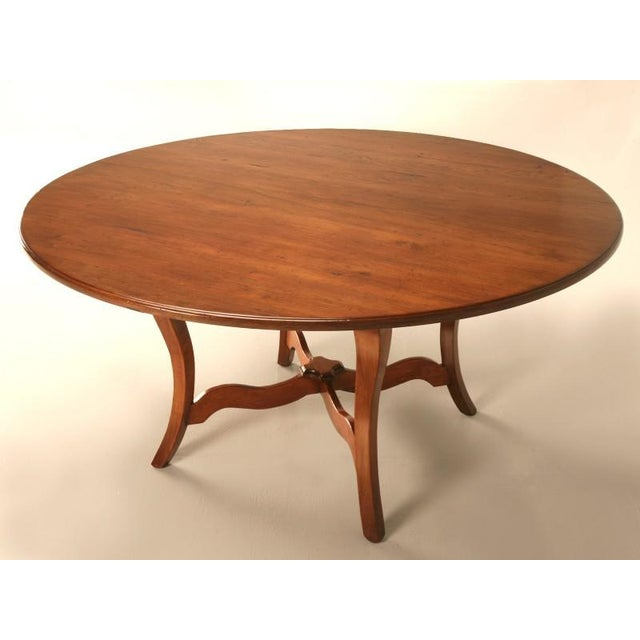 """Vintage 64"""" diameter solid cherry-wood dining table handmade in England. Expertly constructed utilizing real old-world..."""
