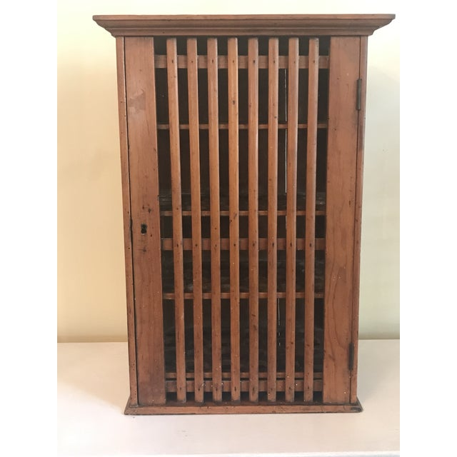 Beautiful vintage French walnut egg wall cabinet. It has a slatted wood door and sides that allow air circulation into the...