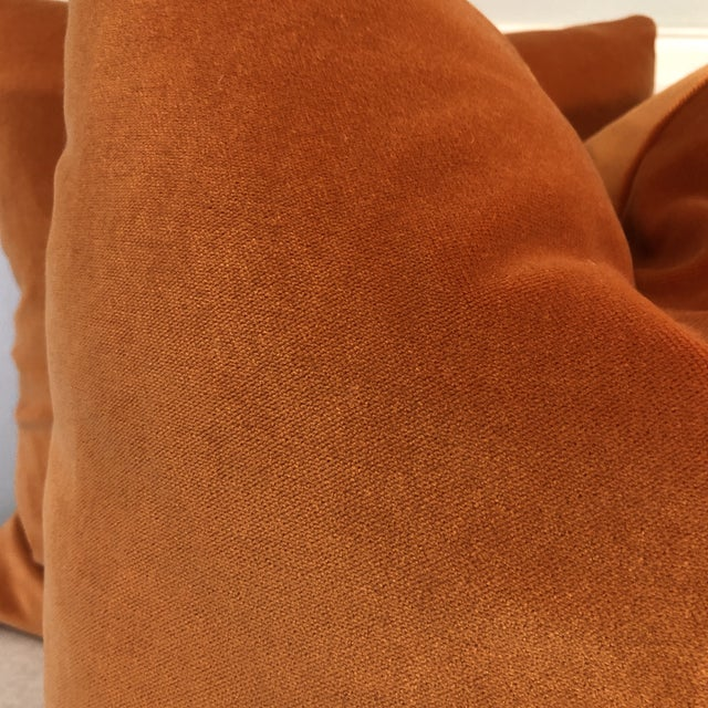 """Custom pair of 22"""" pillows covered in a soft cotton velvet in a bright pumpkin orange color. Pillows have tapered corners..."""