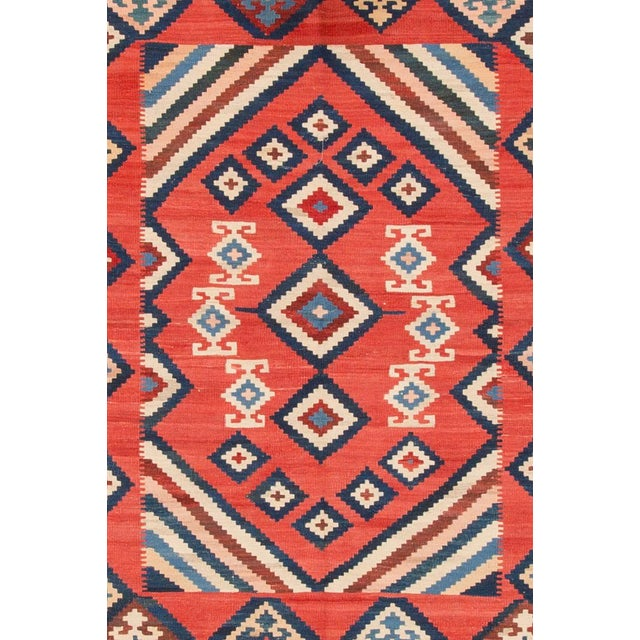 Hand-woven modern Persian Kilim with a geometric design. This piece has magnificent detailing and great colors, it would...