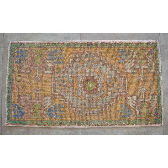 a Vintage Small rug, ecru/sand background color yastik rug perfect for a small guest bath or in front of the kitchen sink