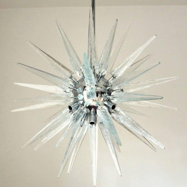 Italian modern sputnik chandelier shown in clear Murano glass shards on chrome metal frame, by Fabio Bergomi / Made in...