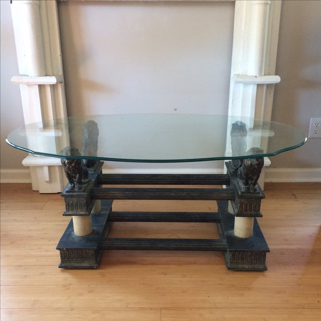 Stunning and ornate coffee table featuring a glass top and a lion-motif base. This will be a beautiful and regal addition...