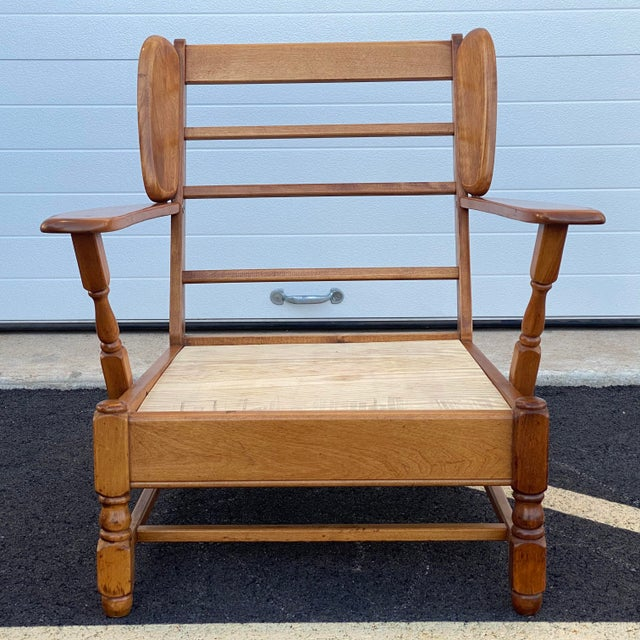 """A rare signed Heywood Wakefield paddle arm lounge chair in solid maple or birch. Seat height without cushion is 11.5""""."""