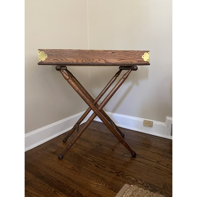 Antique English oak butlers tray on folding base. A handsome piece that can be used as a bar, side table or night stand....