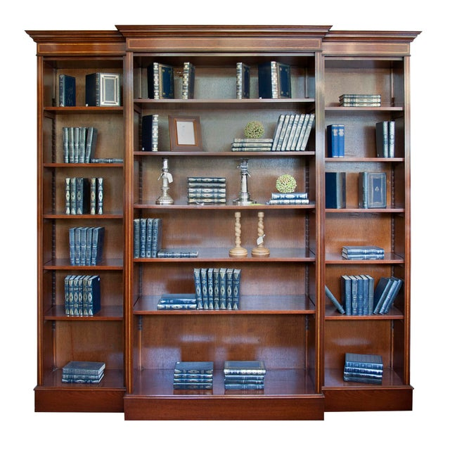 English mahogany triple bookcase with satinwood inlay. Adjustable shelves using wood slats. Comes in five sections for...
