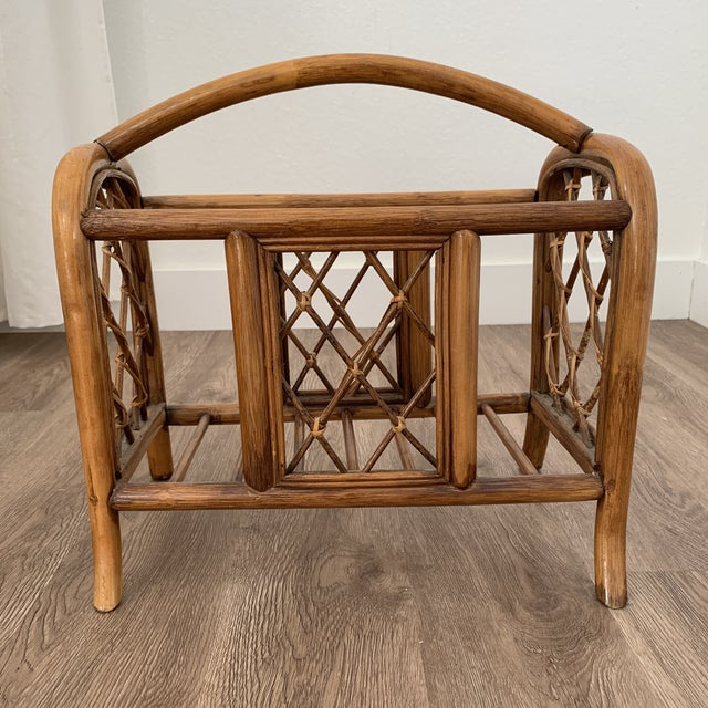 Beautiful vintage rattan bamboo magazine book holder with handle. Stunning addition to your home ! Beautiful and solid...