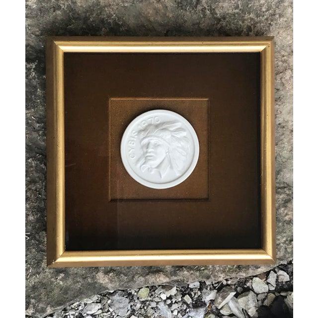 Porcelain intaglio style medallion set upon brown velvet and framed under glass. This medallion design is a rendition of...