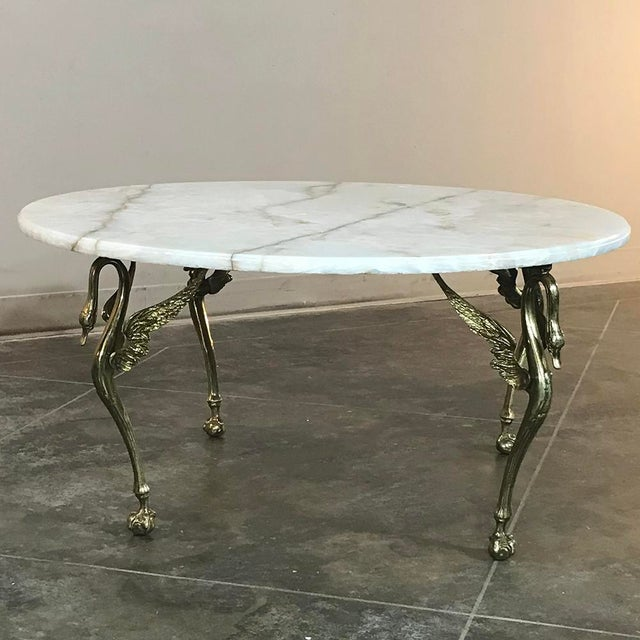 Mid-Century Brass & Onyx Round Coffee Table is the ideal choice for any seating group, with the carefree beauty of marble...