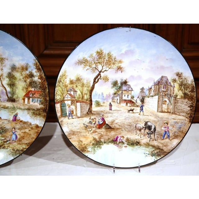 Early 20th Century French Hand-Painted Faience Wall Plates - A Pair For Sale - Image 4 of 10