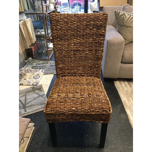 The relaxed woven seat & back of our Kirana Side Chair inspires tranquil visions of coastal or cottage getaways. Solid...