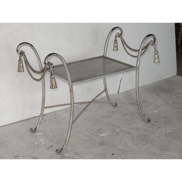 Great Regency style metal bench that has aged look with faux silver leaf. It has wear on surface but bench itself is very...