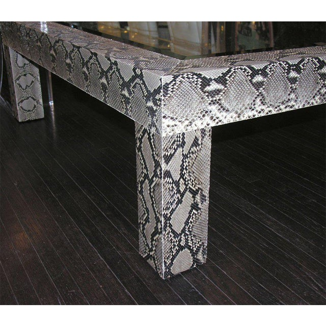 Python cocktail table with inset glass top.