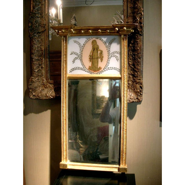 Charming federal giltwood trumeau mirror. Great size for accent or powder room mirror. Original glass.