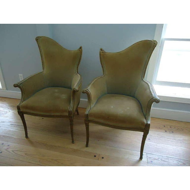 Pair of French Art Deco velvet armchairs with carved gilt wooden trim. Hollywood glamour elegance reminiscent of Dorothy...