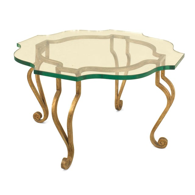 French 'mid-20th Cent' gilt iron rectangular shaped coffee table with 4 double scroll legs supporting a glass top (att:...